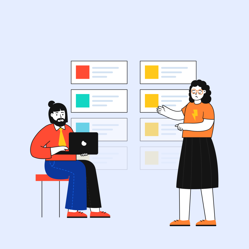 Two designers having a look at the design system that needs an update.